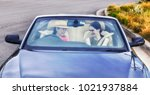 young ladies driving a modern... | Shutterstock . vector #1021937884