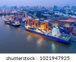 aerial view of containers yard... | Shutterstock . vector #1021947925