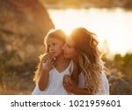 family  mother and daughter at...   Shutterstock . vector #1021959601