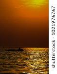 sunset on the ocean and beach... | Shutterstock . vector #1021976767