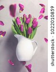 levitating purple tulips... | Shutterstock . vector #1022010859