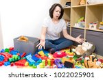 young mother cleaning her kid's ... | Shutterstock . vector #1022025901