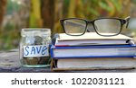 money coins in glass bottles... | Shutterstock . vector #1022031121