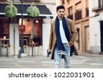 young man wearing winter... | Shutterstock . vector #1022031901