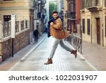 young happy man jumping wearing ... | Shutterstock . vector #1022031907