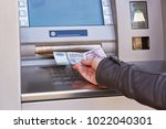 woman hand take out forint... | Shutterstock . vector #1022040301