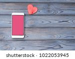smartphone with a pink screen ...   Shutterstock . vector #1022053945