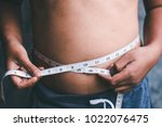 the boys with the waist line... | Shutterstock . vector #1022076475
