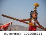 Small photo of Pushkar, Rajasthan, India - November 5 2014 : Little girl doing a tightrope walk carrying a balancing pole in Pushkar
