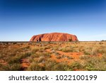 Small photo of Uluru (formerly Ayer's Rock) is a. is a large sandstone rock formation located in Uluru-Kata Tjuta National Park, Northern Territory, Australia. Photographed: May 30th, 2013.