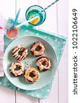 Small photo of Rice pop doughnuts with white chocolate drizzle and sprinkles