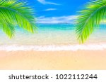 beautiful beach on a background ... | Shutterstock . vector #1022112244
