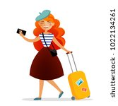 girl traveler with a suitcase ... | Shutterstock .eps vector #1022134261