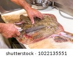 Fish Seller Preparing And...