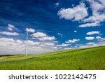 wind turbines on green field in ... | Shutterstock . vector #1022142475