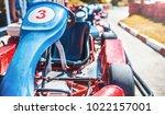 go kart car parked next to... | Shutterstock . vector #1022157001