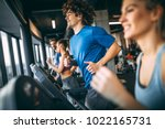 people running on a treadmill... | Shutterstock . vector #1022165731