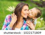 cute daughter kissing her happy ... | Shutterstock . vector #1022171809