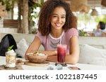 positive young dark skinned...   Shutterstock . vector #1022187445