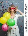 attractive blonde women holding ... | Shutterstock . vector #1022191489