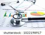 stethoscope  charts and graphs... | Shutterstock . vector #1022198917