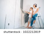 mother and son take off... | Shutterstock . vector #1022212819