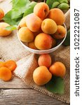 Sweet Apricots In Bowl On Grey...