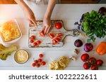 top view of woman cooking...   Shutterstock . vector #1022222611