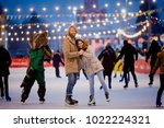 ice skating rink and lovers... | Shutterstock . vector #1022224321