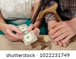 old couple and small coin.... | Shutterstock . vector #1022231749
