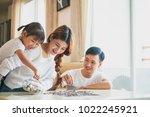family saving money putting... | Shutterstock . vector #1022245921