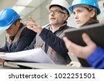 instructor with young people in ... | Shutterstock . vector #1022251501