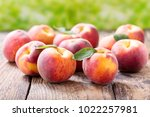 Close Up Of Fresh Peaches On A...