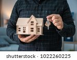man holding house model and key ... | Shutterstock . vector #1022260225