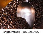measuring spoon and coffe beans | Shutterstock . vector #1022260927