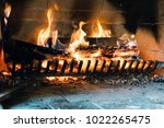 fire in the fireplace. there... | Shutterstock . vector #1022265475