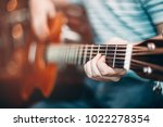 one man play acoustic music... | Shutterstock . vector #1022278354