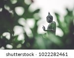 the standing buddha with green... | Shutterstock . vector #1022282461