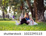 Stock photo asian woman sitting and play with her dog after jogging in the morning dog walking in outdoor 1022295115