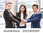 business teamwork stack hands