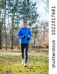 young sports man running in the ... | Shutterstock . vector #1022317681