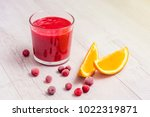 glass of red smoothie from... | Shutterstock . vector #1022319871