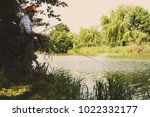 the fisherman is fishing on the ... | Shutterstock . vector #1022332177