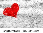 red colored heart manually... | Shutterstock . vector #1022343325