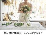 closeup of a female florist... | Shutterstock . vector #1022344117