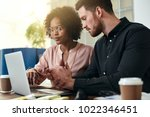 two diverse colleagues working... | Shutterstock . vector #1022346451
