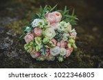 wedding bouquet of flowers in... | Shutterstock . vector #1022346805