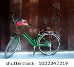 The Green Bicycle Has A Flower...