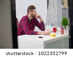 concentrated on work.... | Shutterstock . vector #1022352799