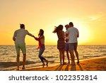 people celebration beach party...   Shutterstock . vector #1022352814